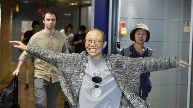 Liu Xia, the widow of Chinese Nobel Prize winning dissident Liu Xiaobo, smiles as she arrives at the Helsinki International Airport in Vantaa, Finland, July 10, 2018.