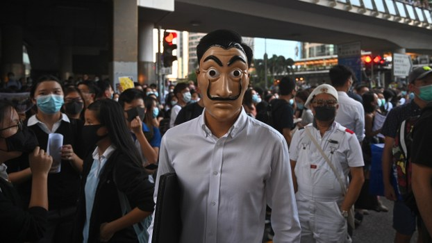 A man wearing a mask takes part in a protest in the Central business district in Hong Kong, Oct. 4, 2019.