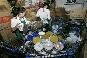 WUHAN, China : Workers remove all brands of baby milk powder from a storeroom at a supermarket in  Hubei province on September 17, 2008.