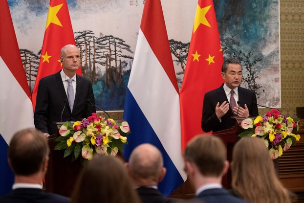 China's Foreign Minister Wang Yi (R) speaks during a joint press conference with Netherlands Minister of Foreign Affairs Stef Blok (L)  in Beijing, June 19, 2019.