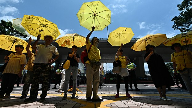 Supporters hold yellow umbrellas after four pro-democracy activists were sentenced at the West Kowloon Magistrates Court in Hong Kong, April 24, 2019.