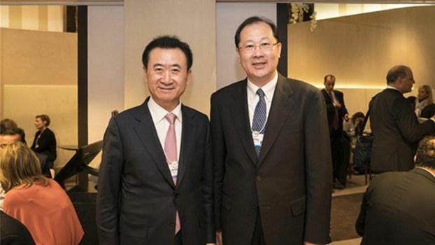 Ren Xuefeng (R), deputy Communist Party secretary of the southwestern Chinese megacity of Chongqing, in photo taken with Wang Jianlin, founder of Dalian Wanda Group, at Davos, Jan. 17, 2017.