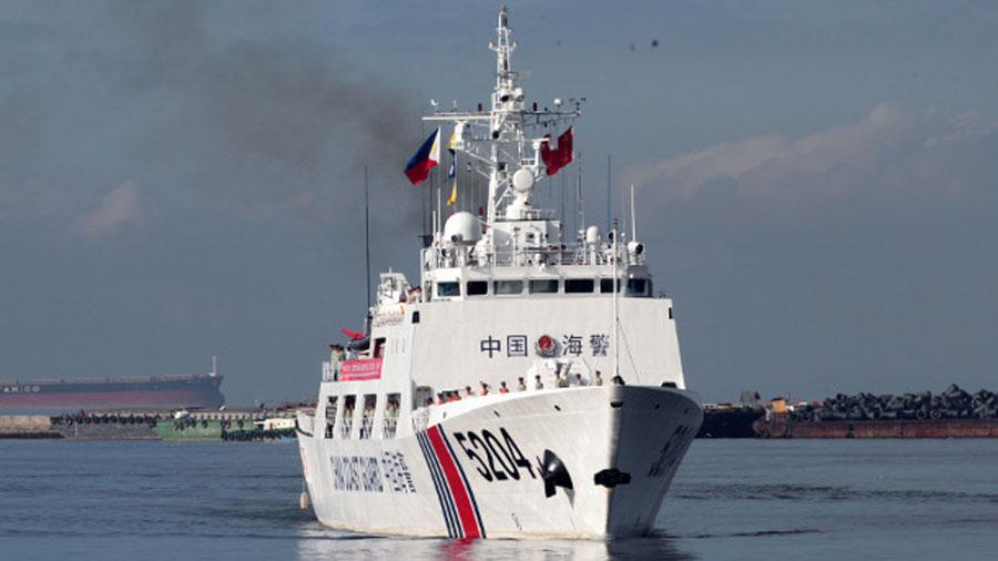 China's Coast Guard ship 5204 prepares to anchor at Manila port, Jan. 14, 2020.