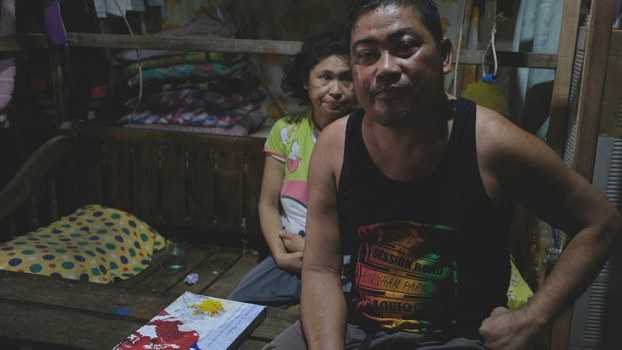 Fishing boat captain Johnny Sonny Geruela and his wife, Maria Leonara, sit in their home Masinloc, Philippines, Sept. 6, 2019.