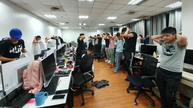 Philippine authorities arrest Chinese workers at an unlicensed online gambling firm in Quezon City, Dec. 19, 2019.