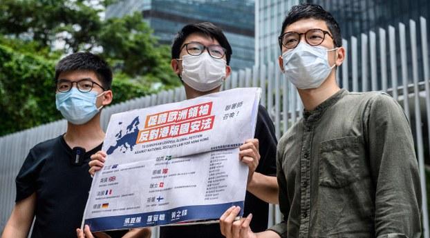 Demosisto Party members Nathan Law (R), Joshua Wong (L), and Sunny Leung (C) urge European action against Hong Kong's national security law, July 3, 2020.