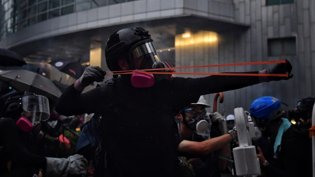 A protester uses a slingshot against the police in Hong Kong, Aug. 25, 2019.