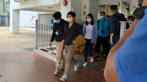 Investigative journalist Bao Choy is taken into custody by Hong Kong police, Nov. 3, 2020.