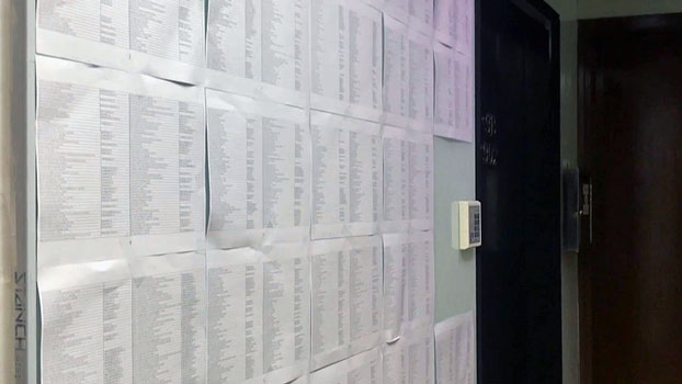 Sheets of paper tacked to the outside wall of an empty office unit in Hong Kong's Sheung Wan area in December 2018 list more than 1,800 firms that are likely shell companies using the location as their main business address. The office is just down the street from a company providing business registration services to mainland Chinese.