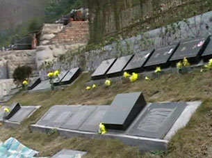 Grave markers of children killed in school collapses during the Sichuan earthquake in Dujiangyan, May 12, 2008.