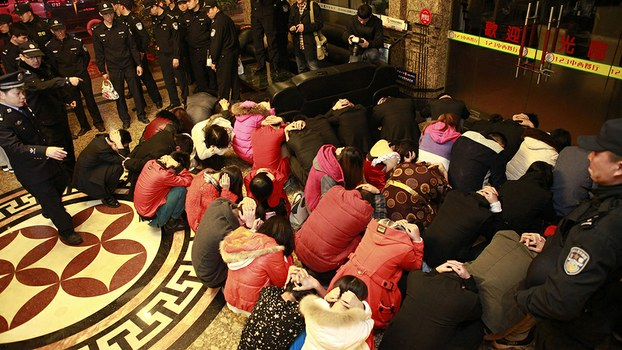 Chinese police round up alleged sex workers and clients at an entertainment center in Dongguan, in Guangdong province, in a file photo.