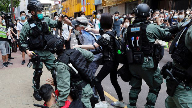 Riot police clash with protesters in Hong Kong, May 27, 2020.