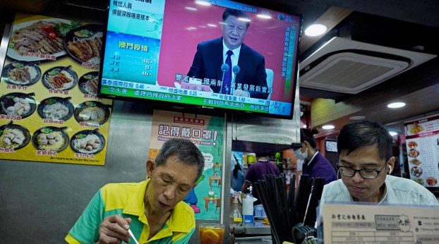 Chinese President Xi Jinping is seen on a TV screen in Hong Kong on the 40th anniversary of the establishment of the Shenzhen Special Economic Zone, Oct. 14, 2020.