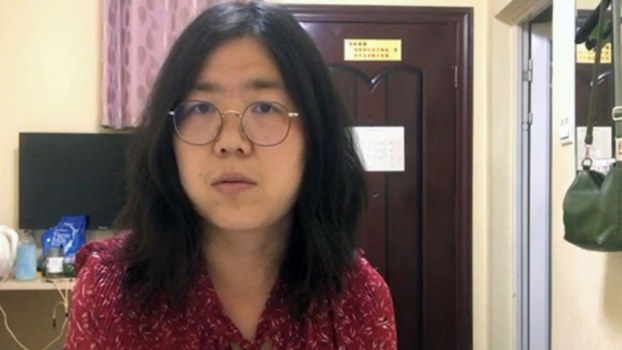Blogger Zhang Zhan, detained after reporting on the Wuhan coronavirus, is shown in a screen shot from video.