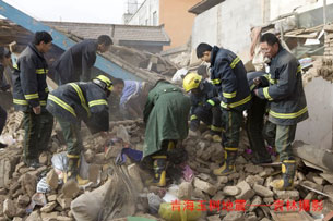 Rescue workers dig through rubble in the aftermath of the April 14, 2010 Qinghai earthquake.