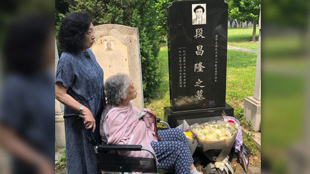 A Tiananmen Mother visits the grave of a relative killed in the June 3-4, 1989 massacre in Beijing, June 4, 2019.