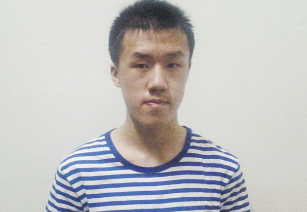 Chinese asylum-seeker Xu Zhenxin is shown after arriving in Thailand, Nov. 20, 2015.