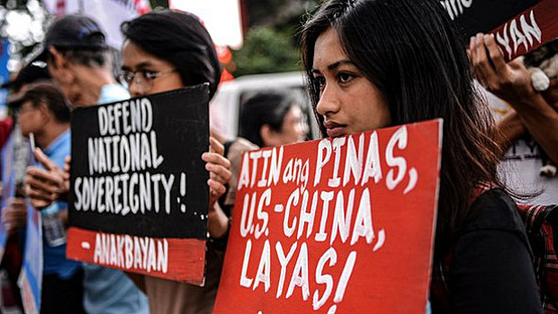 Student activists protest what they call Philippine president Duterte's soft stance toward China's activities in the South China Sea, June 19, 2019.