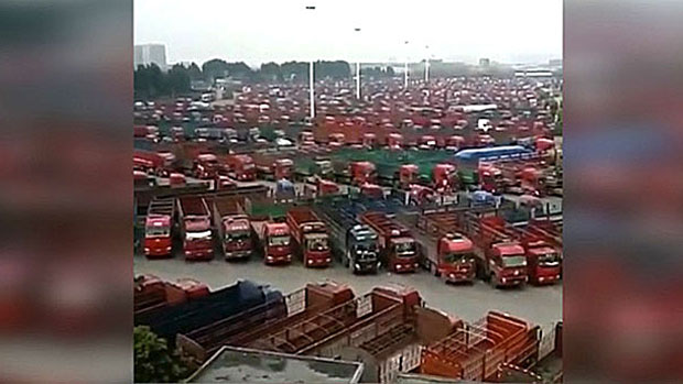 Trucks sit idle in a Shandong, China, parking lot in a screen grab from video, June 8, 2018.
