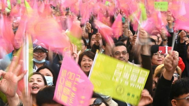 Supporters of Taiwan President Tsai Ing-wen react to her landslide victory outside the campaign headquarters in Taipei, Jan. 11, 2020.