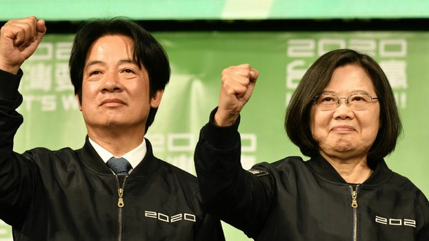 Taiwan President Tsai Ing-wen (R) and Vice President-elect William Lai (L) celebrate her re-election victory at campaign headquarters in Taipei, Jan. 11, 2020.