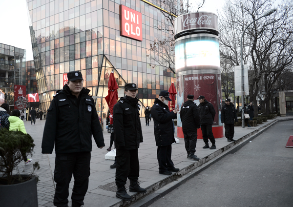 Chinese police patrol Sanlitun, a popular shopping and nightlife area in Beijing, after foreign embassies in China issued a warning about possible threats against westerners, Dec. 24, 2015.