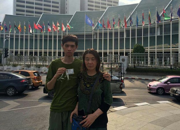 Beijing petitioner Wang Ling and her son Miao Juyou outside the offices of the United Nations in Bangkok, Jan. 16, 2017.