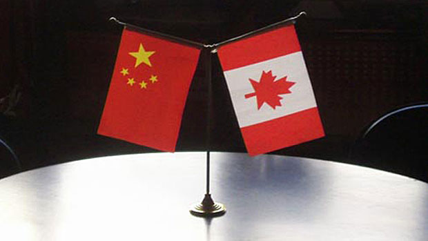 The Chinese and Canadian flags are shown in a file photo.
