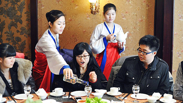 North Korean waitresses serve Chinese customers at a North Korean restaurant in Changchun, northeast China's Jilin province, in a file photo.