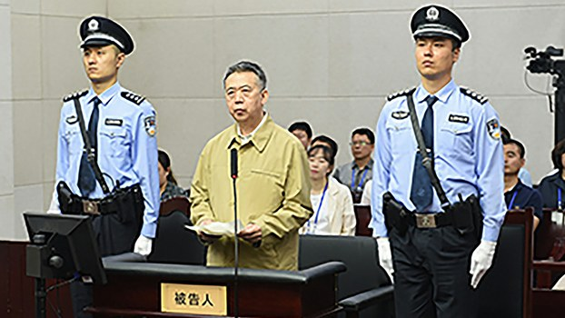 This handout photo released by the Tianjin No. 1 Intermediate Court shows former Interpol chief Meng Hongwei (C) during his trial at the court in Tianjin, June 20, 2019.