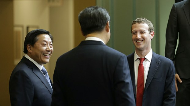 Chinese President Xi Jinping (C) talks with Facebook Chief Executive Mark Zuckerberg (R) and China's then-internet czar Lu Wei (L) at Microsoft's main campus in Redmond, WA, in a file photo.