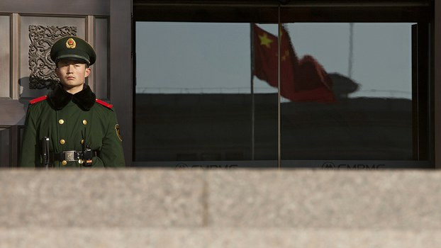 A paramilitary policeman stands guard at the entrance of China's Supreme Court in Beijing, in a file photo.