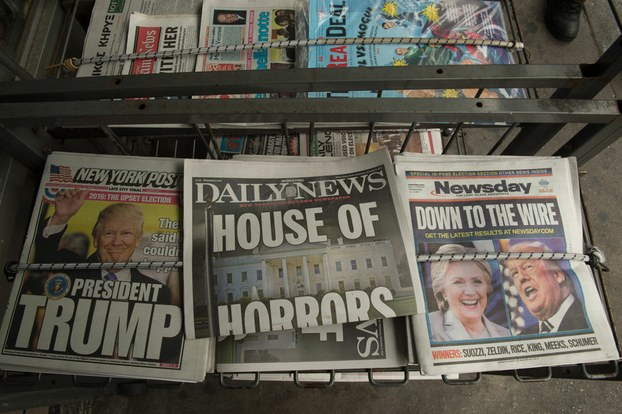 Newspapers for sale in New York following Donald Trump's defeat of Hillary Clinton to take the U.S. presidency, Nov. 9, 201