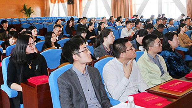 Shandong University Weihai students attend a political meeting, April 2, 2018.
