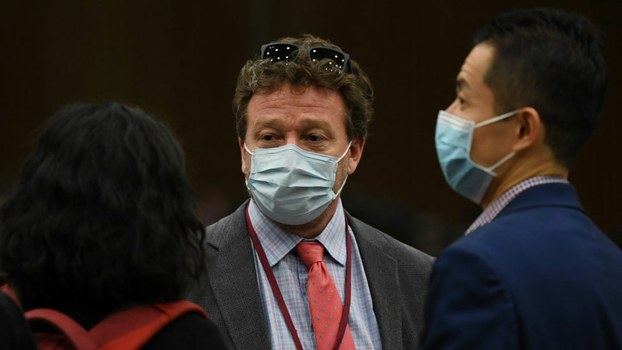 New York Times Beijing bureau chief Steven Lee Myers (C) speaks with other journalists after the daily Foreign Ministry briefing in Beijing which announced  China it would expel American journalists from three major US newspapers, on March 18, 2020.