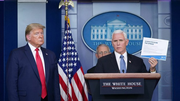 President Donald Trump and Director of the National Institute of Allergy and Infectious Diseases Anthony Fauci (2nd L) listen as Vice President Mike Pence speaks during the daily briefing on the novel coronavirus, COVID-19, at the White House. in Washington, March 24, 2020.