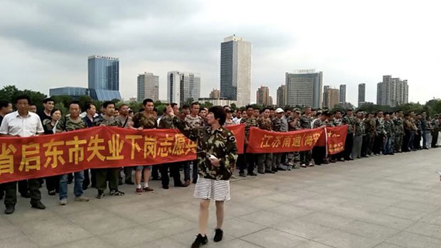 People's Liberation Army (PLA) veterans from across China gather in in Zhenjiang city in the eastern province of Jiangsuto join protests over the beating of a fellow veteran earlier this month, June 24, 2018.