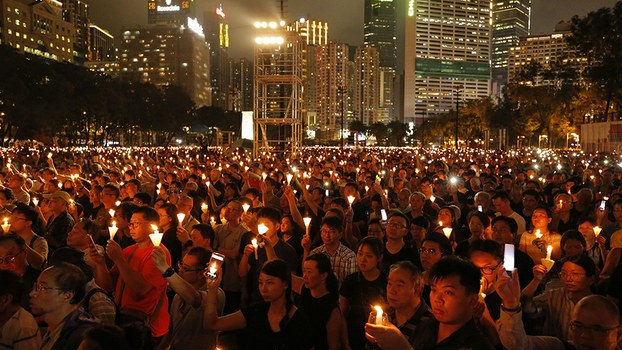 Thousands attend a candlelight vigil for victims of the Chinese government's military crackdown three decades ago on protesters in Beijing's Tiananmen Square at Victoria Park in Hong Kong, June 4, 2019.