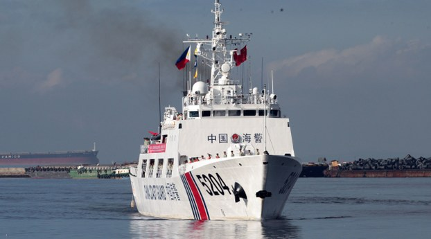 A Chinese Coast Guard ship prepares to anchor in Manila in the Philippines, Jan. 14, 2020.