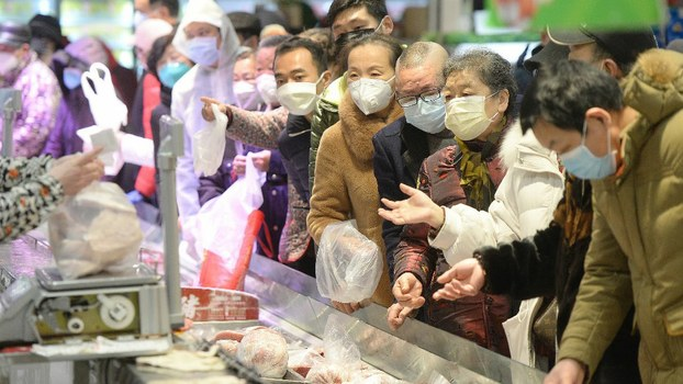 People wearing protective masks shop at a supermarket in Wuhan, the epicentre of the outbreak of a novel coronavirus, in China's central Hubei province.