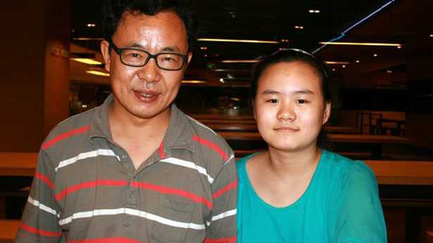 Zhang Lin (L) and his daughter Zhang Anni (R) in an undated photo.