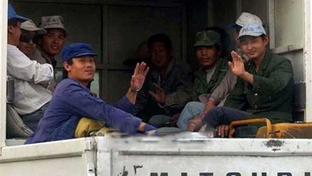 North Korean workers in Kuwait ride a truck in this undated file photo.