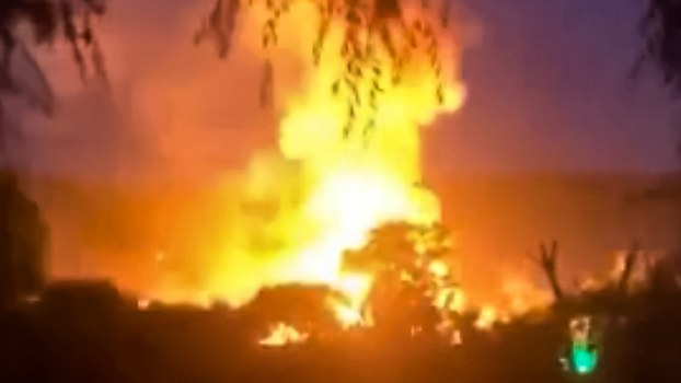 A screenshot from a video shows fire engulfing a building in Hyesan city, in North Korea's Ryanggang province, Aug. 3, 2020.