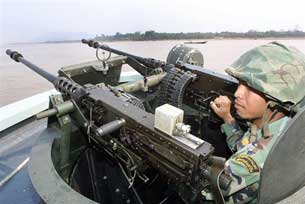 A Thai Navy boat patrols the Mekong river near the Thailand/Burma border.