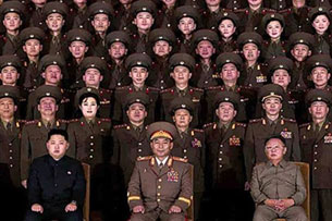 Undated photo shows Kim Jong Il (front R) and Kim Jong Un (front L) with the military's 'State Merited Chorus' in Pyongyang.