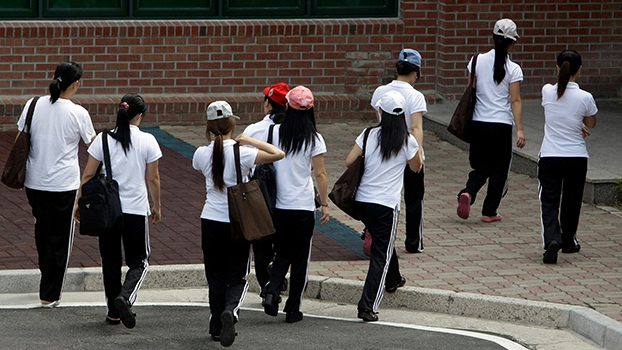 In a file photo, women who defected from North Korea to South Korea walk for their class at the Hanawon, a state-run official shelter for North Korean defectors.