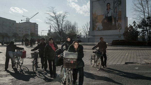 Cyclists pass along a road in Chongjin, Nov. 19, 2017.