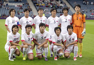 North Korea's women's Olympic soccer team poses before its match against Colombia in Scotland, July 25, 2012.