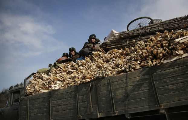 North Korean soldiers ride in a truck carrying firewood in Wonsan, North Korea in this file photo.