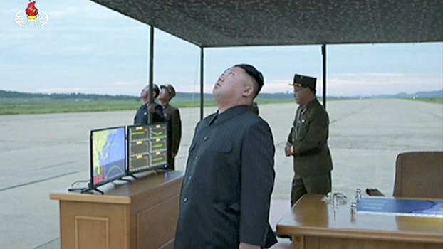 Kim Jong Un looks up at the sky at what is said to have been a missile launch on Aug. 29, 2017 from an undisclosed location in North Korea, in an image made from a video of a news bulletin aired by North Korean government broadcaster KRT.